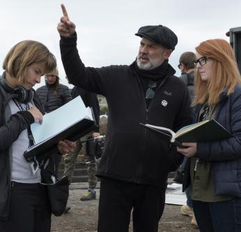 Director Sam Mendes discusses the scene with Script Supervisor Nicoletta Mani and Co-writer Krysty Wilson caims